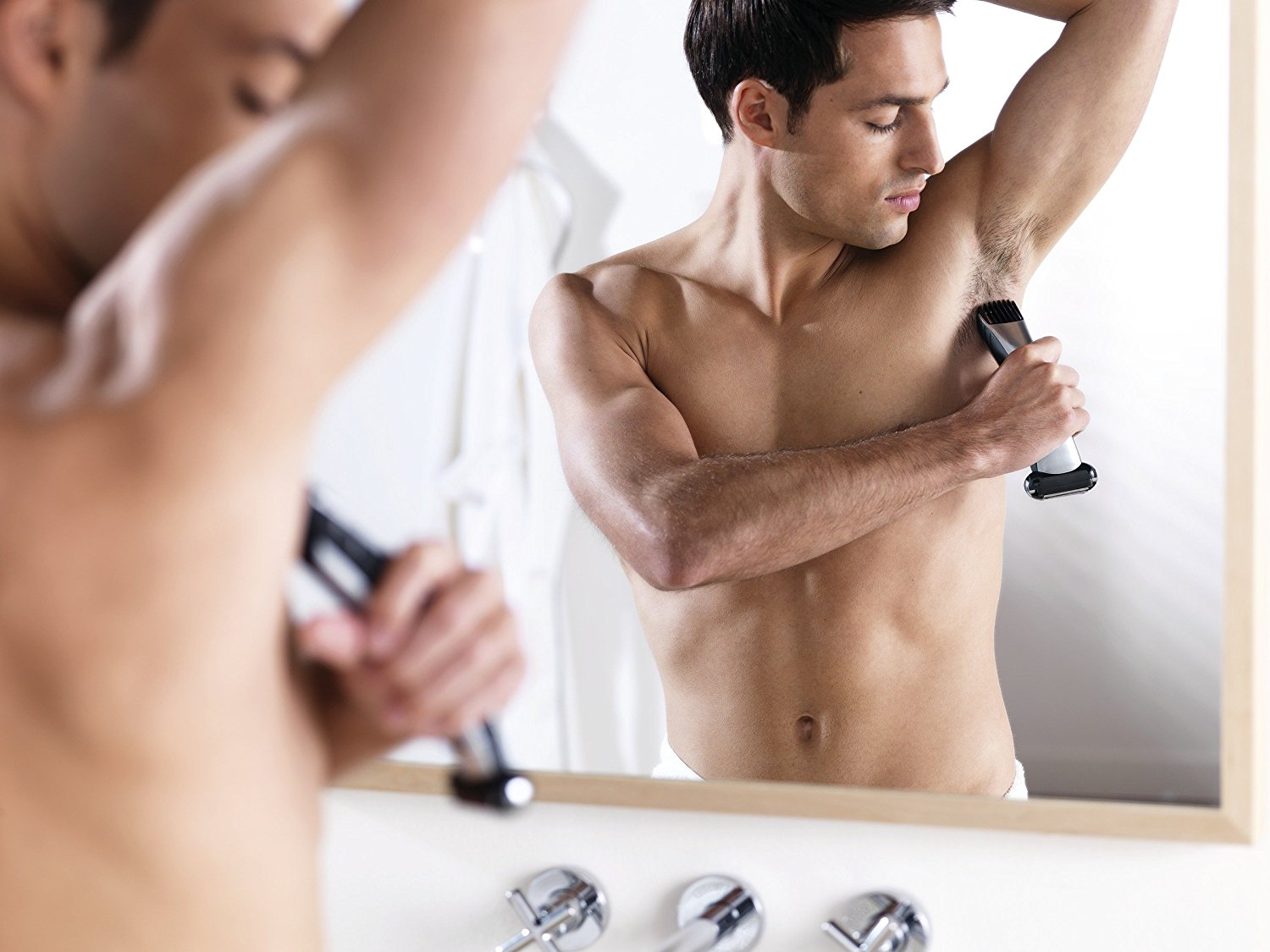 Men shaving his armpits