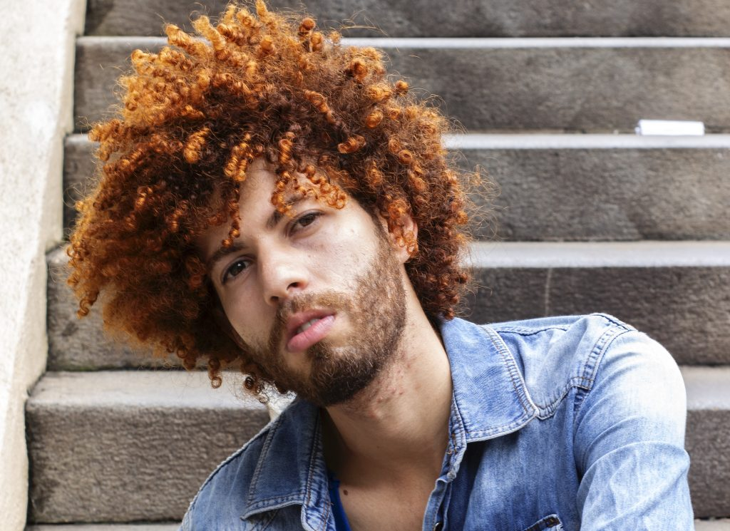 styling long curly hair men